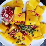 Fruit salad with mango, passion fruit, pomegranate