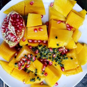 Fruit salad with mango, passion fruit, pomegranate