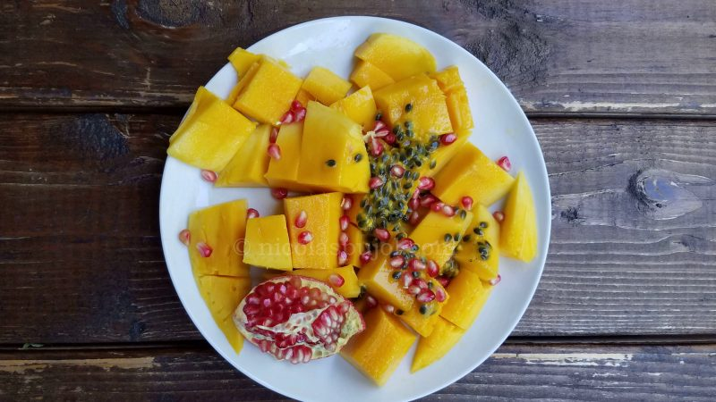 mango passion fruit and pomegranate breakfast