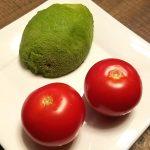 Avocado and tomatoes for vegan oatmeal