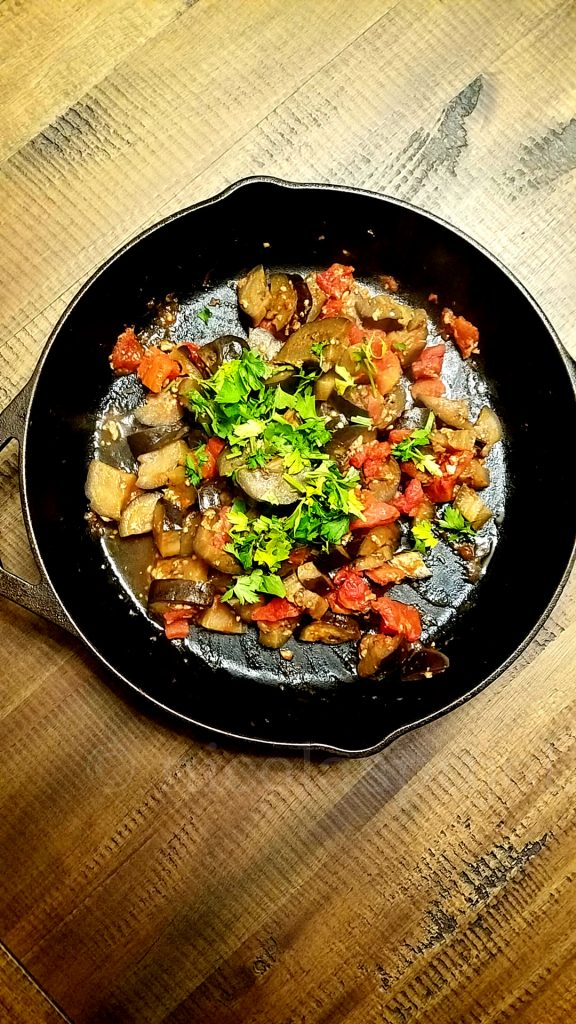 Sauteed eggplant dish with garlic diced tomatoes and parsley