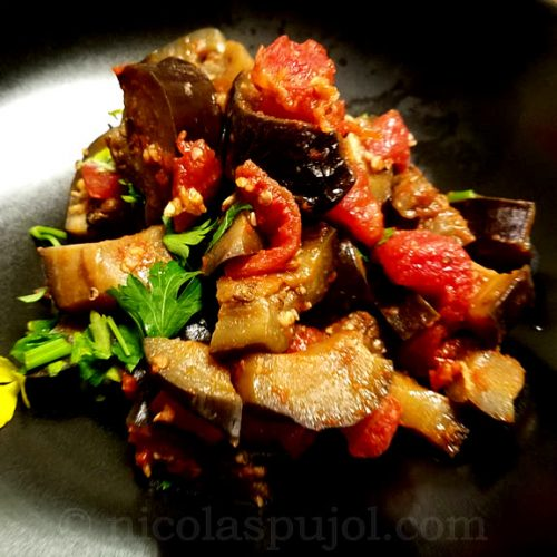 Vegan eggplant with diced tomatoes garlic parsley