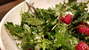 Baby kale salad with lemon and olive oil dressing