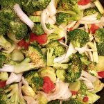 Broccoli in tomato sauce cooking process