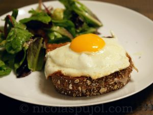 Croque madame with French lettuce salad
