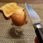 Cut the egg top with a small sharp knife