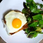 French croque-madame with lettuce salad