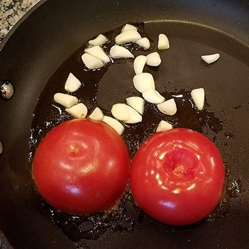Fry the tomatoes on one side with the garlic