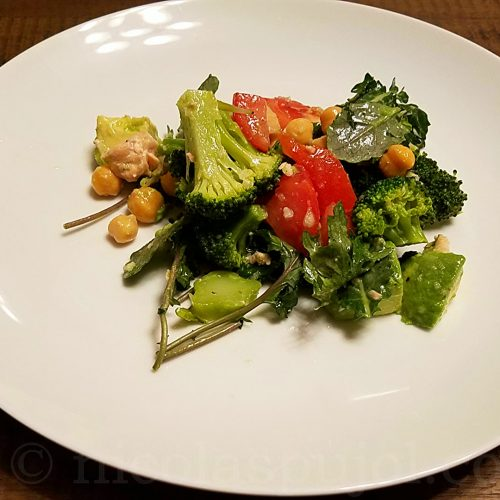 Garbanzo beans avocado tomato salad with lemon dressing