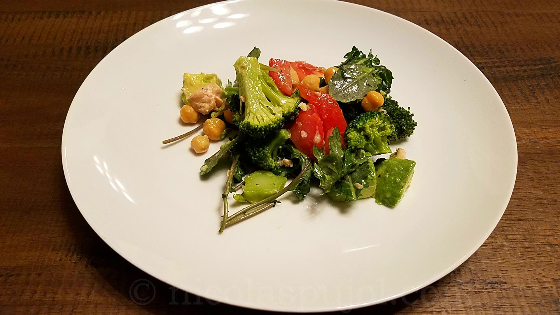 Garbanzo beans avocado tomato salad with lemon dressing