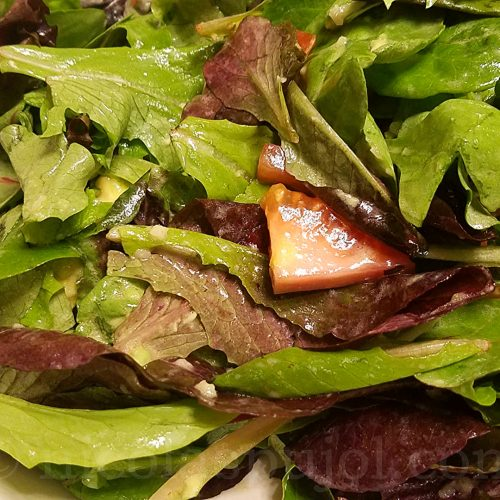 Simple lettuce salad with French lemon dressing