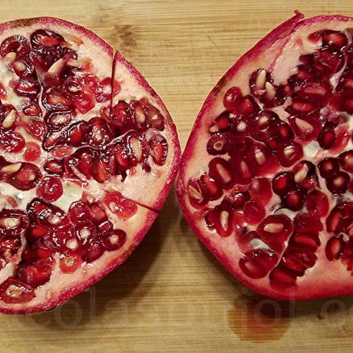 Slice pomegranate into halfs