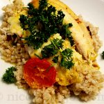 Baked tilapia with coconut milk, spices, served with brown rice