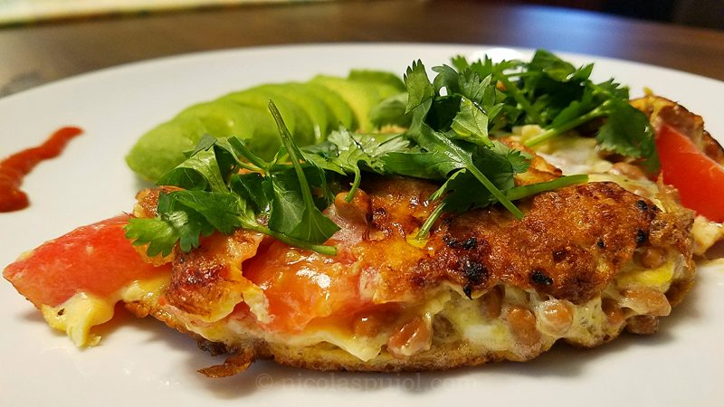 Delicious natto omelette, cooked in Provence style for a Japanese-French fusion recipe.