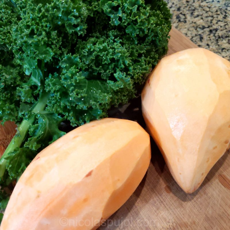 Peeled sweet potatoes and kale for salad preparation