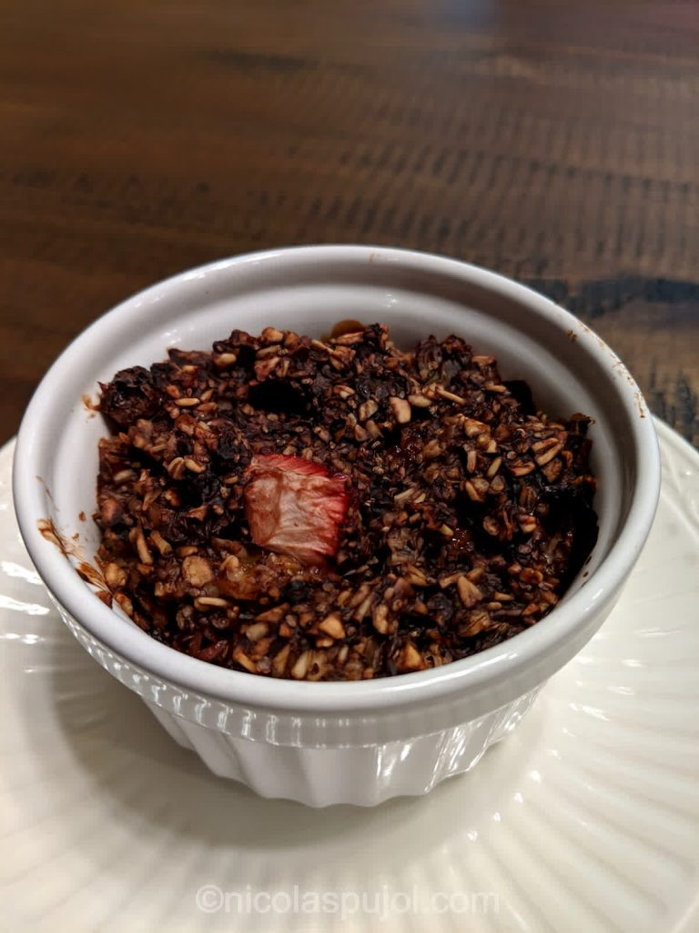 Baked oatmeal with chia seeds fruits and cocoa powder