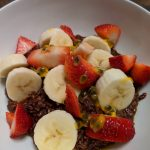 Chocolate oatmeal topped with fruits