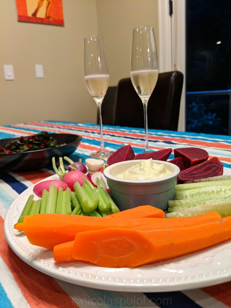 Decoration with sparkling wine and vegan aioli platter