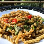 Oil-free pasta salad with arugula tomato and garbanzo beans