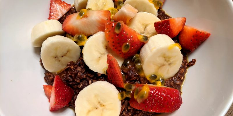 Vegan unsweetened chocolate oatmeal with fruits