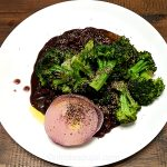 seared broccoli and onion in black bean base
