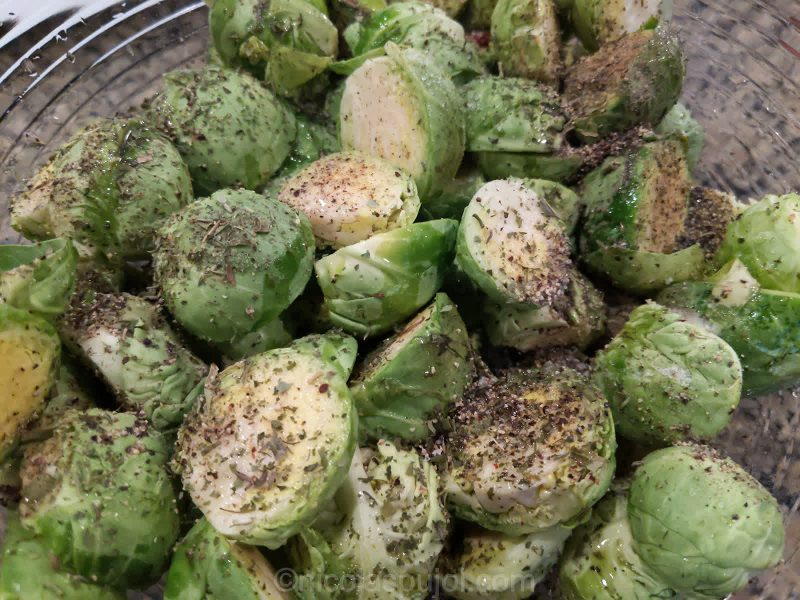 Add herbs and pepper and rub sprouts with hands