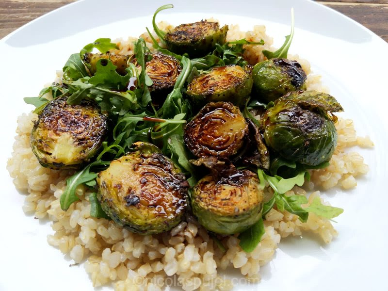 Baked Brussels sprouts on bed of arugula and brown rice