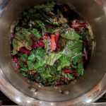 Boil beet greens for a few minutes