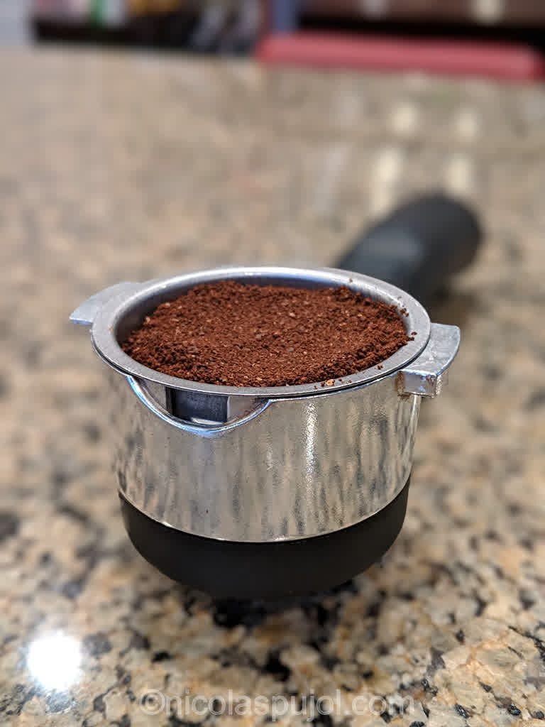 Fresh ground espresso coffee for vegan cappuccino