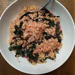 Kale cooked in oatmeal with lemon juice dressing