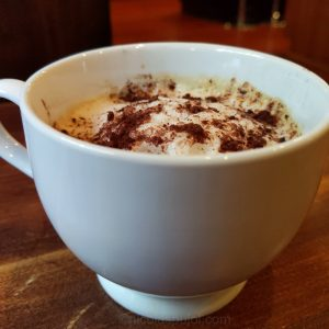 Vegan cappuccino coffee with unsweetened cocoa powder