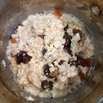 mix in dry fruits into cooking oatmeal