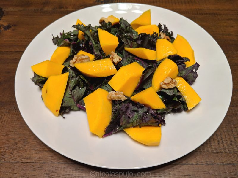 Almond mango kale and lemon juice salad without oil