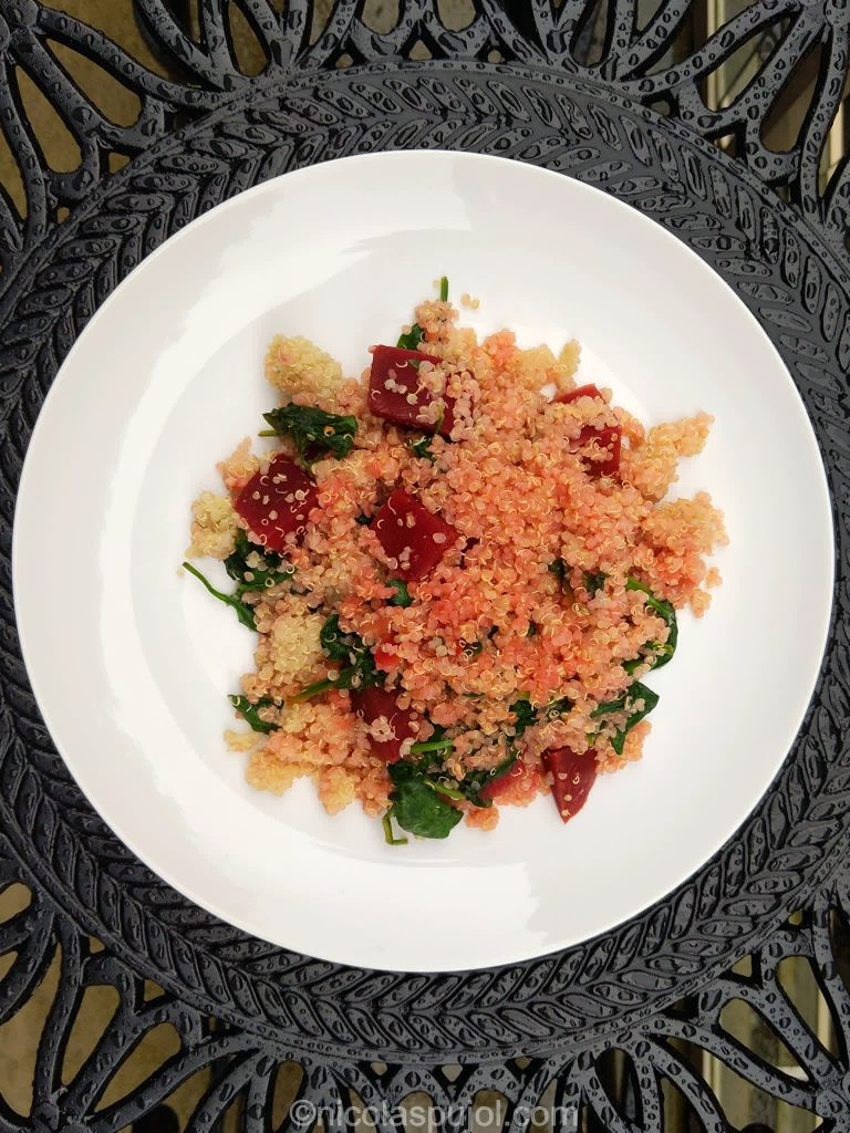 Oil-free quinoa salad with orange dressing, beets and spinach