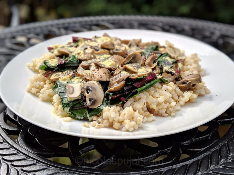 Rice with mushrooms, beet greens and lemon sauce