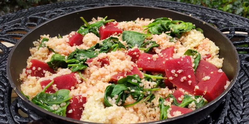 Spinach and beets in quinoa and orange dressing