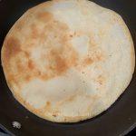 Vegan soy milk crepe on a non-stick pan