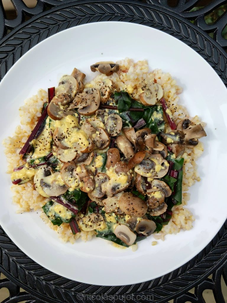 Mushrooms over beet greens and rice with French dressing