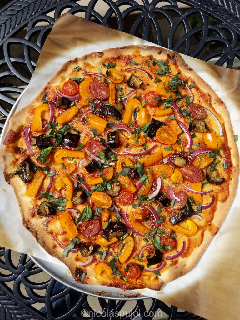 Plant-based pizza with barbecue sauce bell peppers eggplants and tomatoes
