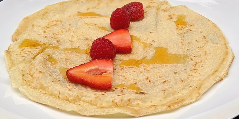 Soy milk vegan crepe with berries and maple syrup