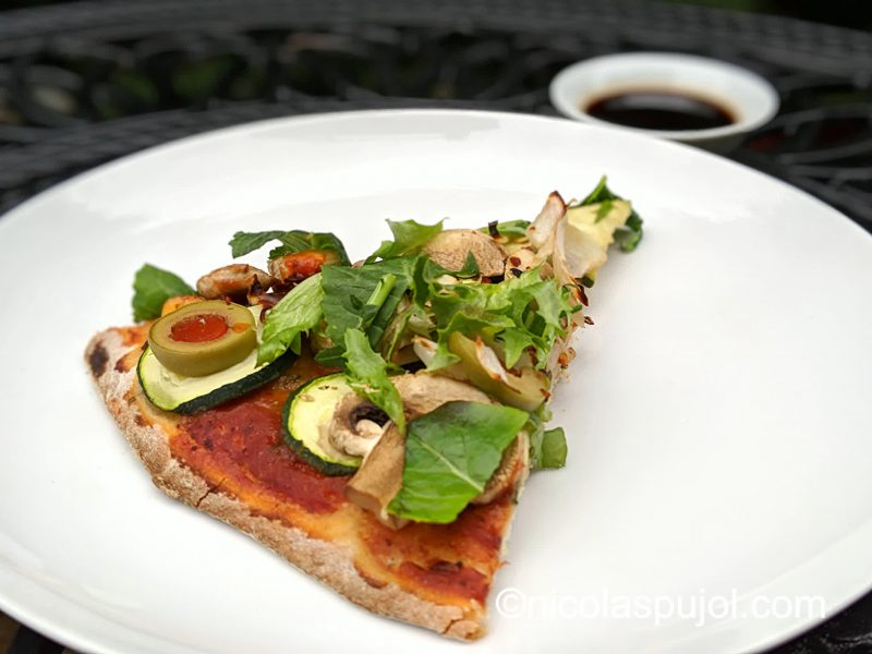 Vegan pizza with balsamic vinegar dressing